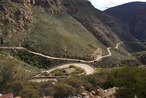 Up and over the Swartberg Pass. Not for the faint-hearted but nevertheless a stunning mountain pass with views to die for. See More: http://www.where2stay-southafrica.com/blog/destinations/up-and-over-the-swartberg-pass