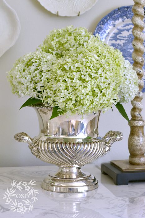 Using a Silver Champagne Bucket as a Vase. I have pink and blue Hydrangeas in mine as we speak. I also love to use Peonies.  #sparklingeverafter