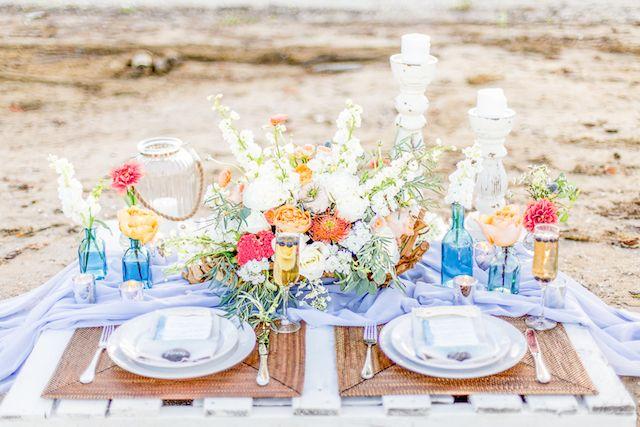 Colorful beach wedding tablescape | Lauren Werkheiser Photography | see more on: http://burnettsboards.com/2016/02/beach-wedding-unique-color-palette/