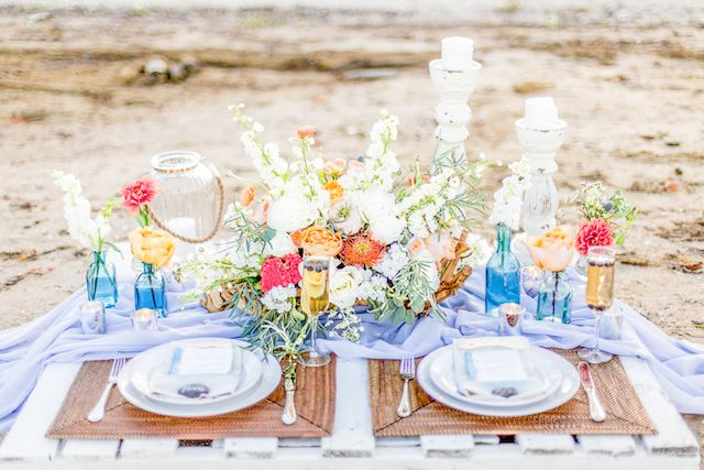 Colorful beach wedding tablescape | Lauren Werkheiser Photography | see more on: http://burnettsboards.com/2016/02/beach-wedding-unique-color-palette/