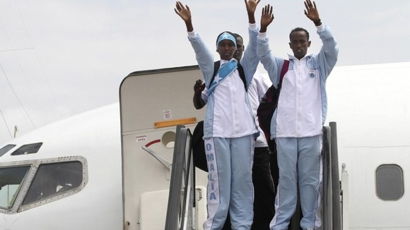 """The Somali Olympic team arrives in London ahead of the Olympics. """"I am very much excited. It's un-imaginable that I'm coming from a country destroyed by 21 years of conflict to compete with (players from) serene, peaceful and developed countries that have never seen war."""" Zamzam will compete in the women's 400 metres and Mohamed Mohamed Hassan will take part in the men's 1,500 metres.    Arriving at Heathrow Airport Zamzam said that """"Somalia is alive"""" and she is proud to represent her…"""