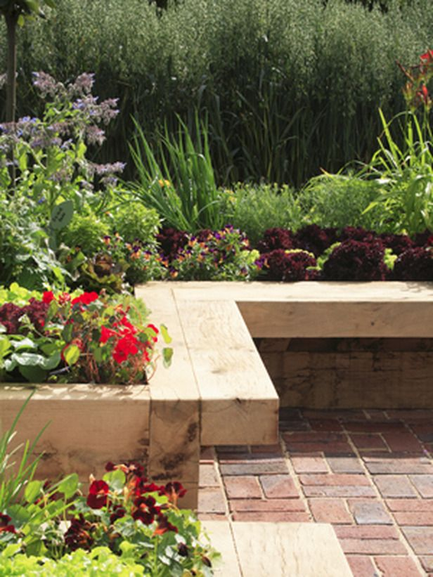 Raised bed with a ledge to sit on while you work.