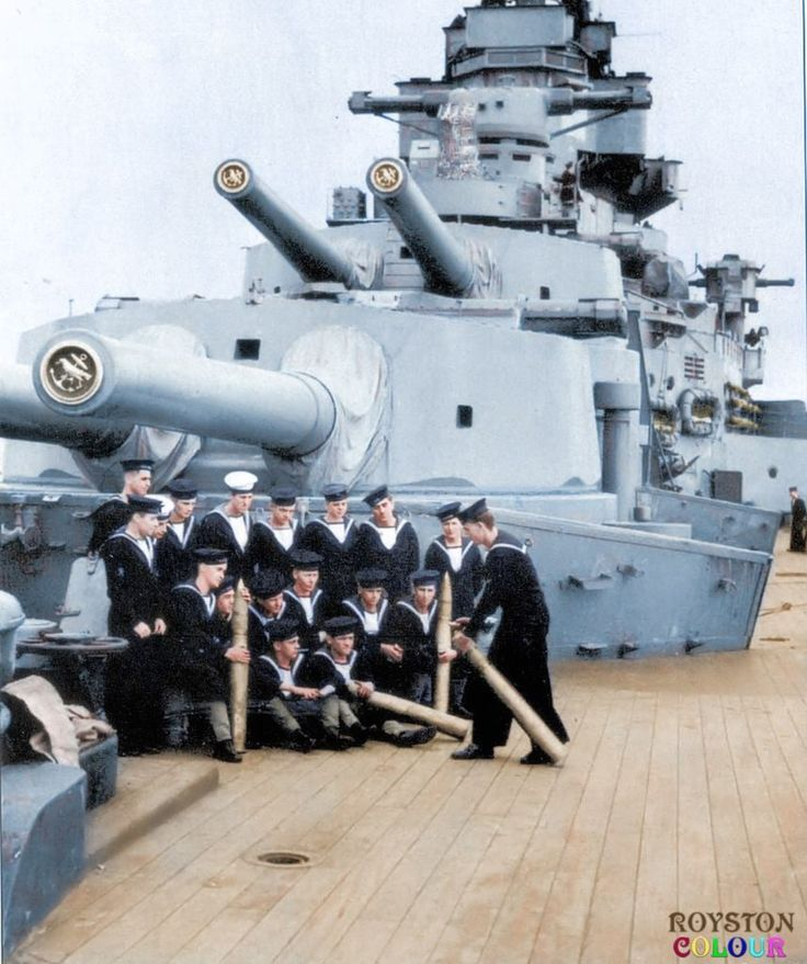 "A and B turrets, HMS Hood 1940 HMS Hood's forward 15"" turrets, with a 4"" gun's crew under training in the foreground. The leading seaman, (noted) standing on the extreme left, behind the man with the 4"" projectile, is leading seaman W Dowdell, who lost his life on 24 May 1941 along with 1414 other members of the ship's company, there being just three survivors when the ship was sunk in action by the German battleship Bismarck.