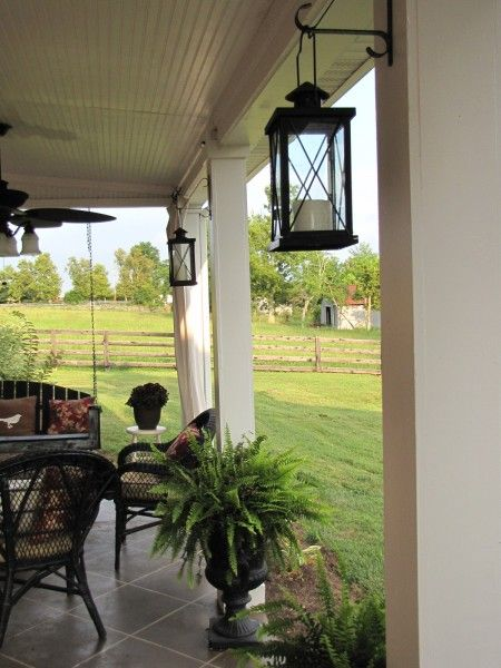 Patio hanging lanterns, urn with fern & add outdoor draperies.:
