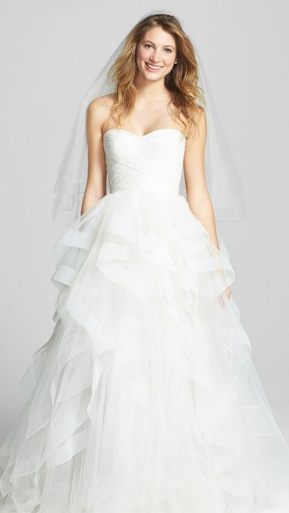 Romantic lace and a sweetheart-neckline bodice make this feel like a fairytale gown!