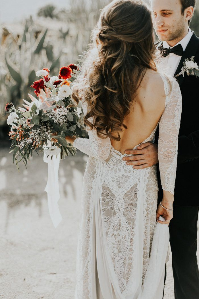 Elegant bridal hair + a stunning lace gown by Grace Loves Lace   Image by By Amy Lynn