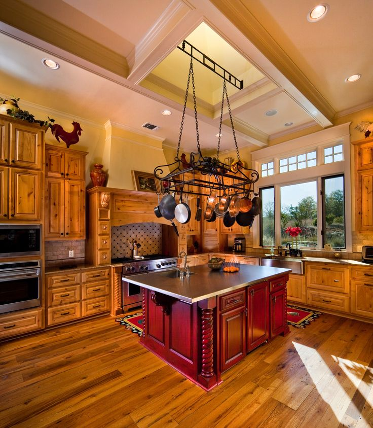 Knotty Alder Cabinets And Reclaimed Oak Flooring Are Elegant In This Kitchen