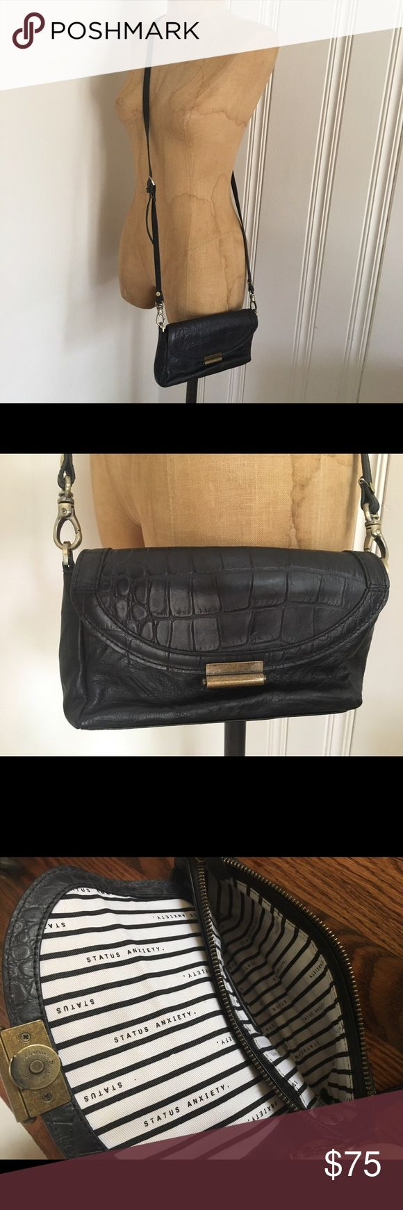 Status Anxiety black leather crossbody bag 'I See You Baby' bag. Real leather. Got it about 3 years ago. Still available on their website. Worn a few times. A friend yanked on the strap and one of the rivets (?) popped out 😔 Should be repairable. I never use it b/c I have a child and little bags just don't work for me anymore. Status Anxiety Bags Crossbody Bags