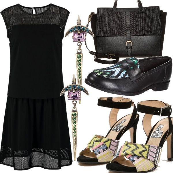 Un outfit dallo stile metropolitano con un pizzico di etno-afro e colore per ravvivare il total black. Il vestito lascia intravedere spalle e gambe, raffinato e adatto sia di giorno che di sera, abbinato a mocassini e tacchi alti.