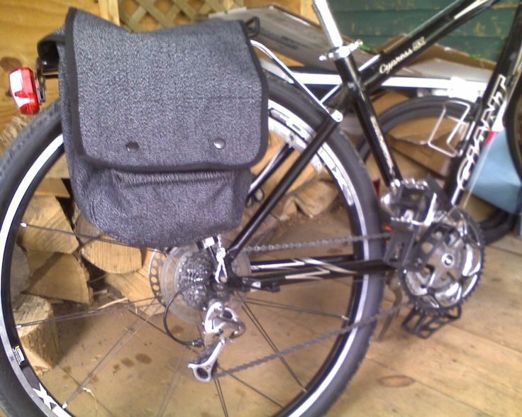 You can buy $12 map bags from a military surplus store and with some strap, bungee cord, and rivets, attach them to your bicycle rack for sturdy, unique paniers.