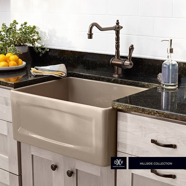 "The Hillside 24"" Apron Kitchen Sink, shown here in Oyster with the Victorian Kitchen Faucet, provides a deep cavity and a look that is steeped in country heritage."