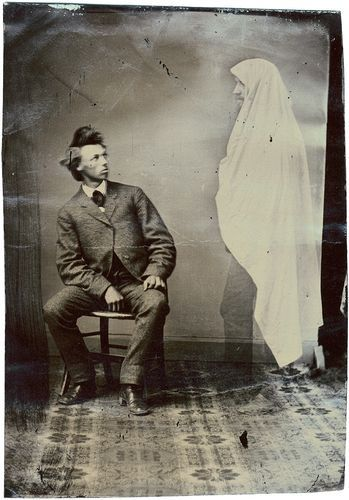He looks as annoyed as I'd be. ca. 1880, [tintype portrait of a gentleman with a spectral apparition] via the Northern Light Gallery, Andrew Daneman Collection of American Tintypes