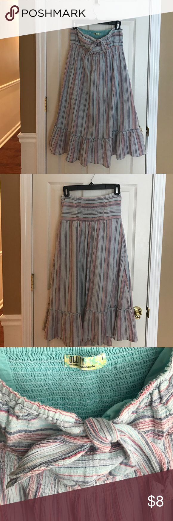"""Old Navy strapless sundress Gauzy cotton in chambray stripe with hints of red and navy. Smocking under bustline and on back for a snug fit. Ruffle detail along bottom and tie along bustline. Length along side seam is approximately 30"""" total, along under bust is about 14"""", from top elastic to under bust 5"""" and width along bottom hem is about 32"""". In excellent condition. No signs of wear or stains. Old Navy Dresses"""
