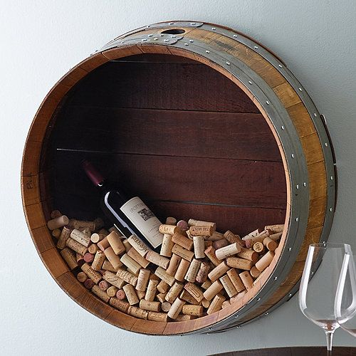 Retired wine barrel turned into a piece of art.  Easily add corks while on the wall.  Solid construction holds larger display items