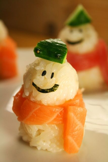 Easy-to-Make Cute Snowman Sushi (Sushi Rice Body, Salmon or Maguro Tuna Sashimi Scarf, Nori Face and Cucumber Hat)