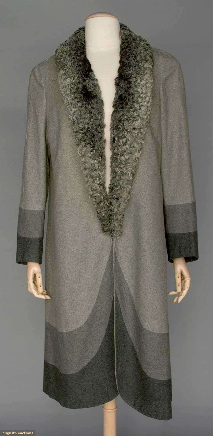"""DECO SPRING WOOL COAT, 1928 Light gray wool flannel, 3/4 length, gray curly lamb shawl collar, sleeve & hem w/ inset curved bands of darker gray & charcoal wool flannel, unusual seaming on back of coat, gray silk lining w/ hidden pocket, labeled """"Bergdorf Goodman"""", Sh-Sh 15"""", L 45"""""""