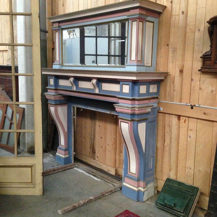 cheminée à deux étages en bois massif double patine rechampis ,partie supérieur miroir ,foyer en marbre  .XX siècle .