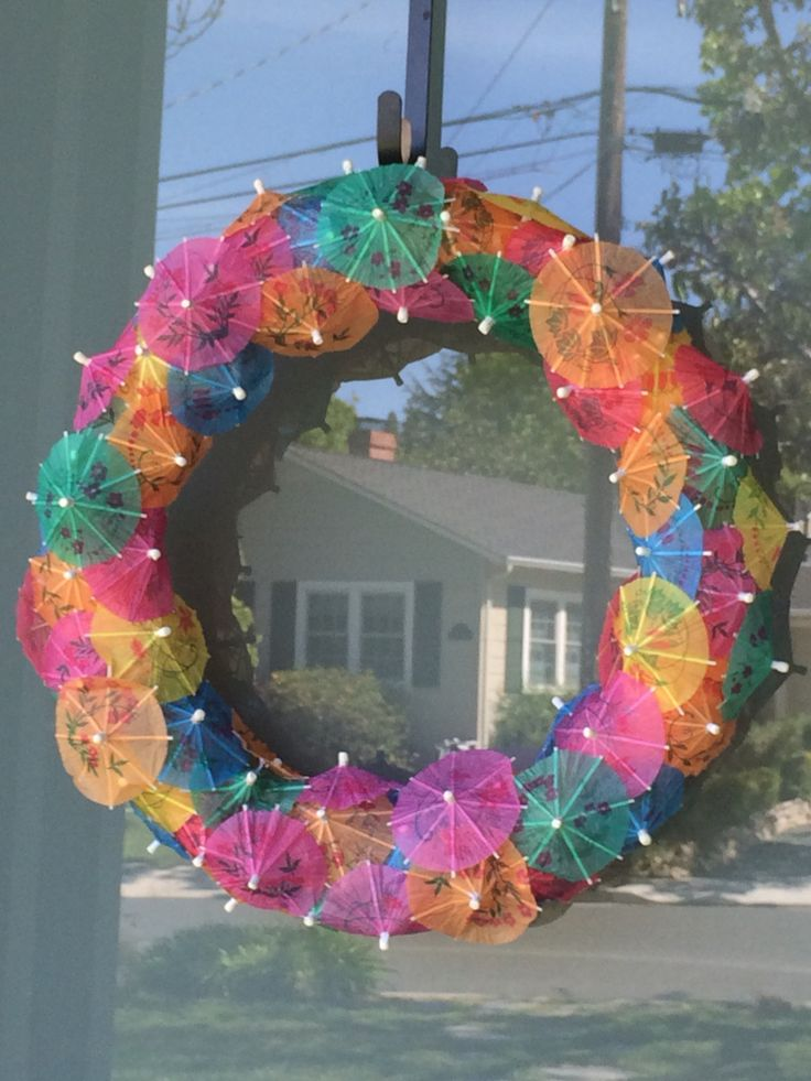 Hawaiian cocktail umbrellas. Pool noodle wreath. Luaus or summer celebration.  Summer 2015  under $10 wreath, summer wreath, beach party, luau, Hawaiian, tropical, summer craft, cocktail umbrellas, pool noodle form