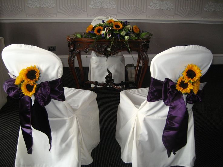 Sunflower and Calla Lily Registrars table arrangement and floral chair decorations, with purple ribbon.