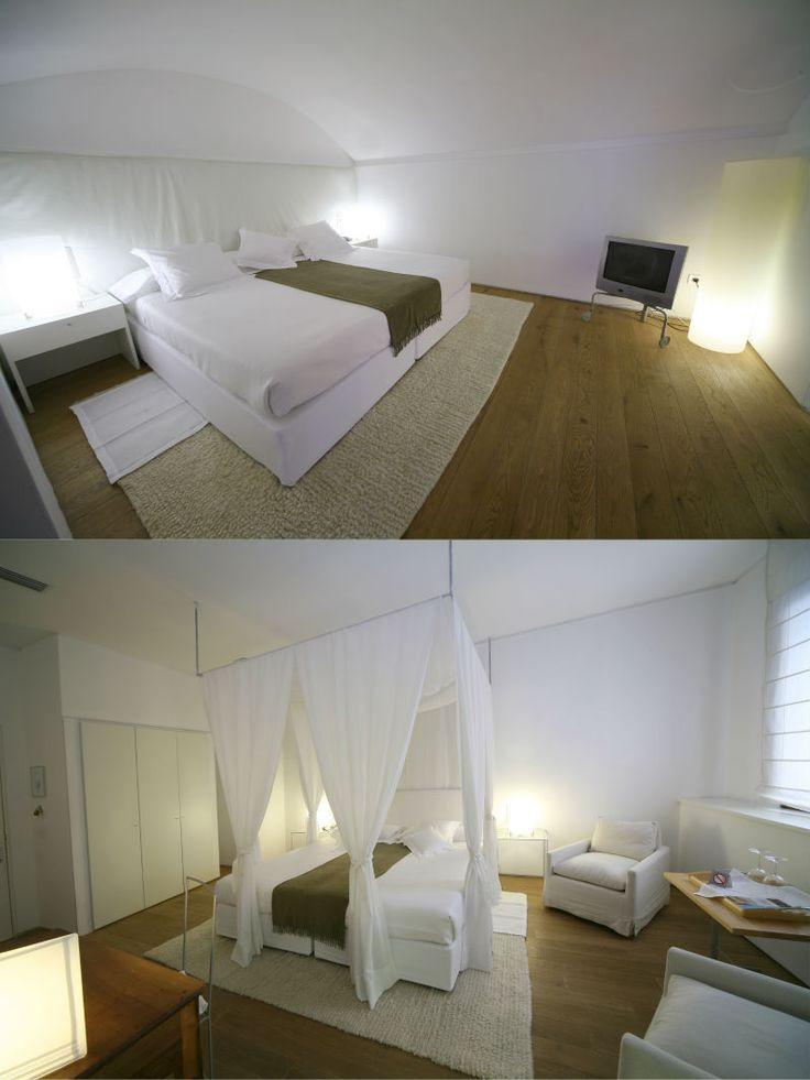 Convent de la Missió | Boutique Hotel | Palma de Mallorca | Spain | http://lifestylehotels.net/en/convent-de-la-missio | bedroom, double bed, white, minimalistic, luxury, relax, natural light, wooden floors, curtains, canopy, four-poster bed