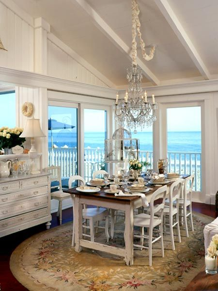 ocean view dining ...and while we at it, I love the rug and chandelier.