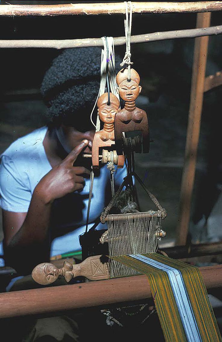 "Africa | Woman weaving strips of cloth on a 4"" loom. 