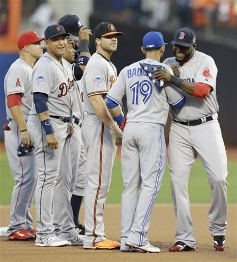 American League's David Ortiz, right, of the Boston Red Sox, is greeted by American League's Jose Bautista, of the Toronto Blue Jays, during introductions for the MLB All-Star baseball game, on Tuesday, July 16, 2013, in New York. (AP Photo/Kathy Willens)