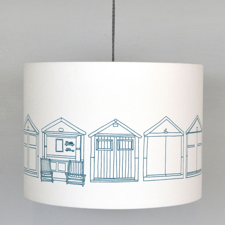 A beautifully handmade lampshade featuring Beach Huts in teal. This  lampshade is made with our screen printed cotton fabric, and bonded to a  fire retardant PVC backing with taped edges. All lampshades are handmade in  Brighton.   Each lampshade is handmade and can be used either as a ceiling pendant or  for a lamp base.   20cm H x 20cm D / £45  22cm H x 30cm D / £60  24cm H x 40cm D / £75  UK Postage only / £6  Joanna Corney creates architecturally inspired patterns for the home. Her…
