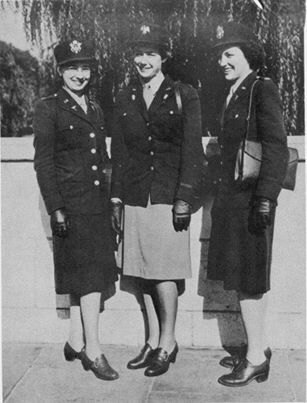 "Army Nurses (left and right) and WAC officer (in the middle) in olive-drab service uniforms. Army female nurses were provided with OD uniform in 1943. The design was adopted from the revised WAAC (renamed WAC) uniform. The WAC officer is dressed in popular uniform variant known as ""Pink and Greens"" which became optional in the later stages of World War II ~"