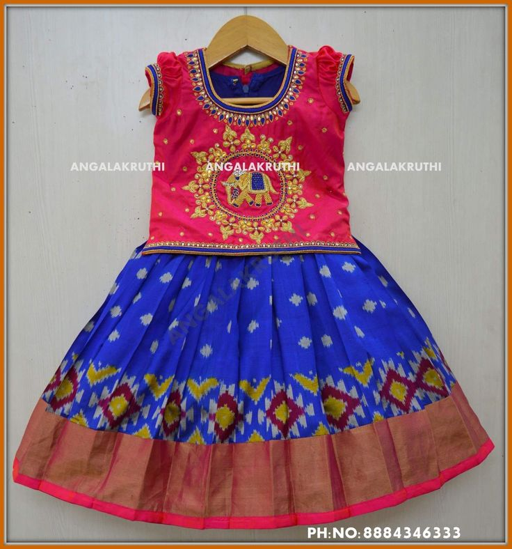 Ikkat silk Lehenga for kids by Angalakruthi boutique Bangalore Watsapp:8884347333 Silk pavada designs  #Pattu Pavada designs by Angalakruthi boutique Bangalore  with Maggam work Hand Embroidery designs on kids lehenga by Angalakruthi