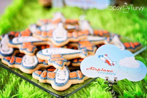 a powdered sugar icing recipe and a step by step tutorial for beautiful decorated cookies for any occasion like these airplane cookies
