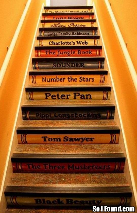 Charming--book spines painted on stairs.
