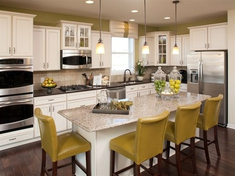 White cabinets contrast with dark counters and a rich wood floor. The Edgewater Model by Ryland Homes. The Interlaken community, near Minneapolis-St. Paul, MN. #StartFreshBuyNew
