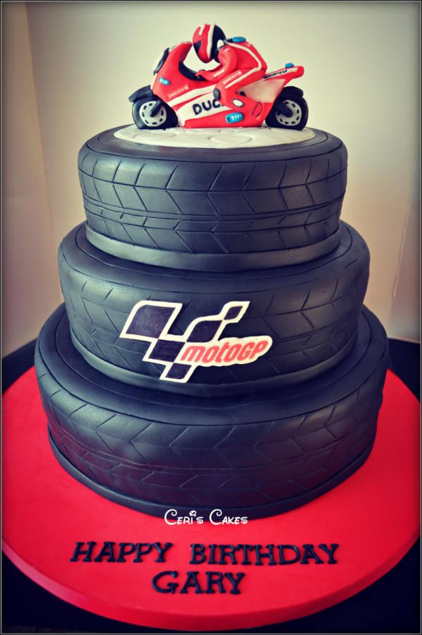 "12"" 10"" and 8"" Vanilla sponge with vanilla buttercream and strawberry jam. All the tiers are tyres with a Ducati motorbike on the top. https://www.facebook.com/CerisCakesJersey"