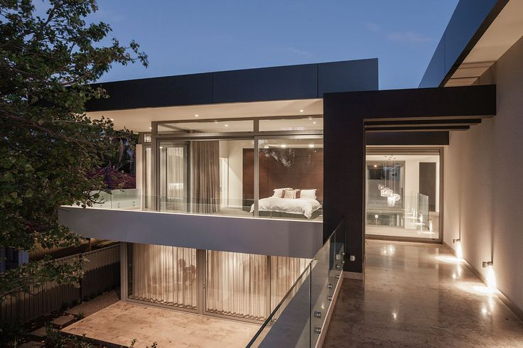 Clean lines with different materials including limestone and alucabond create a dramatic exterior façade to this home designed and built by Urbane Projects, Perth.