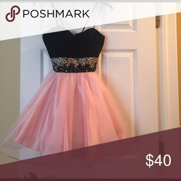 Teen size 6 strapless party dress Teen strapless party dress size 6. Fits a girl about 90 pounds and less than 5 feet tall. The dress has a band of sequins around the middle in black, silver and pink. The dress has crinoline to make it stand out a little. Camille Dresses Formal