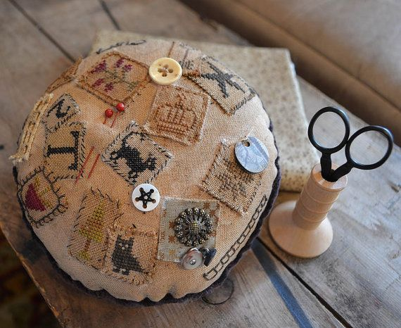 Passport Pincushion is a project design of mine.  The instructions come with a page full of motifs and complete instructions with full-color photographs to make your very own Passport Pincushion.