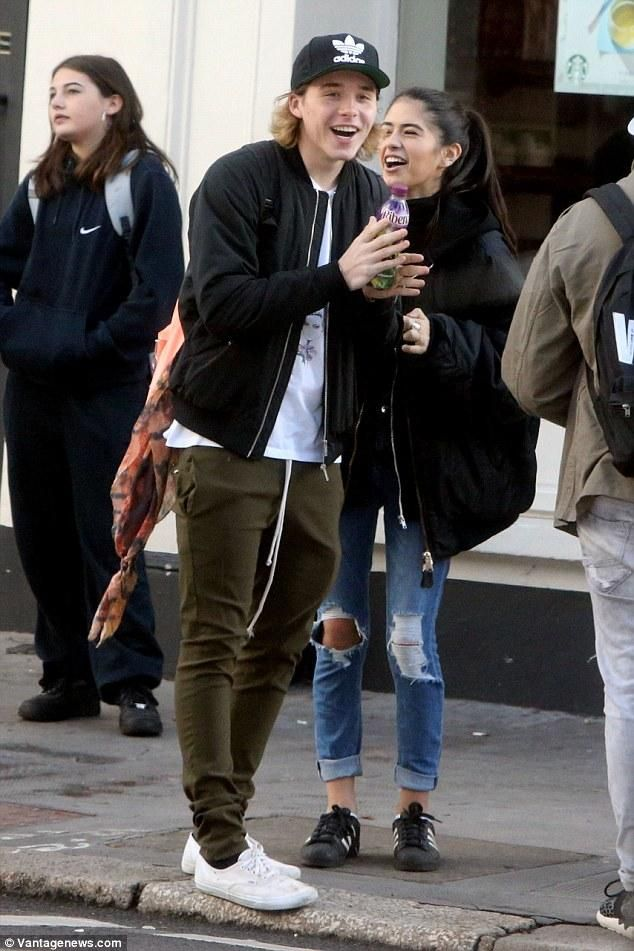 Brooklyn Beckham wearing Vans Authentic Sneaker and Jansport Superbreak Backpack in Coral Peaches