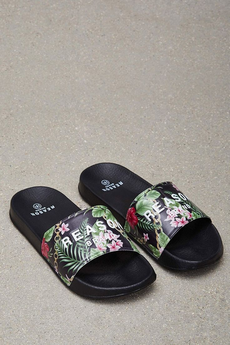 "A pair of lightweight slides by Reason™ featuring a tropical print with an embossed ""Reason Brand"" graphic."