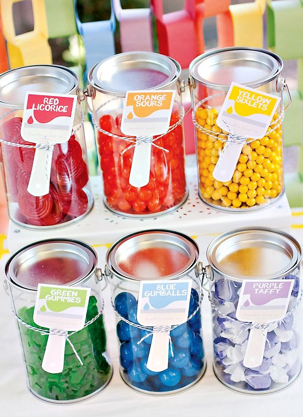 rainbow paint party: candy displayed in clear plastic paint cans. Find tall quarts here: http://www.thecarystore.com/containers-catalog/packaging-and-containers-plastic-containers-plastic-paint-cans-clear-plastic-art-cans/1-quart-tall-clear-can-with-ears-bail-and-lid-30WK7C