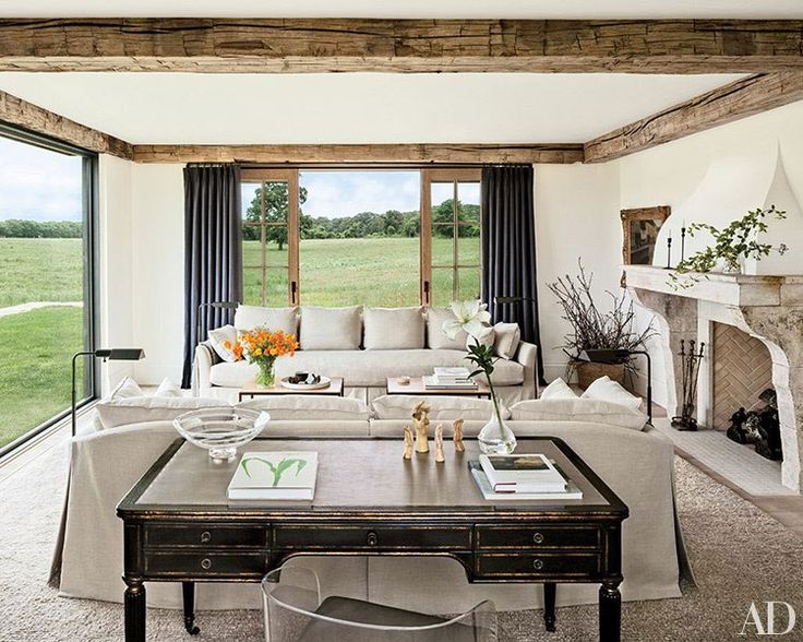 In the living room of the family's Martha's Vineyard house, pasture views are framed by sliding doors.
