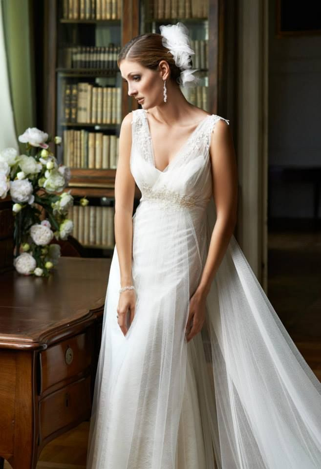 We love this Margarett Firenze wedding dress