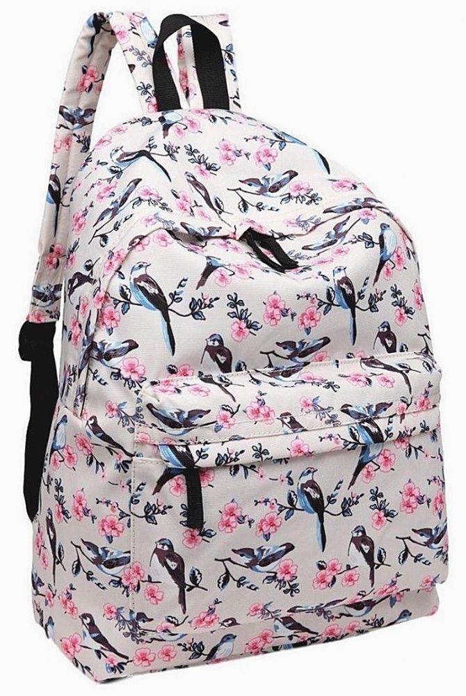 A cream backpack rucksack with a bird and flower print premium quality thick canvas fabric with adjustable shoulder straps Fastens with a zip large