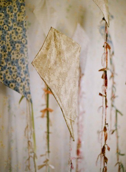 beautiful vintage fabric made into hand stitched kites for spring afternoons - wouldn't it be lovely to embroider them with names or favorite quotes? gorgeous photo by Elizabeth Messina  for the Ruche Enchantment Spring line
