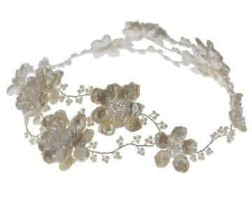 Hermione Harbutt Florrie Headdress. Pearl and Swarovski crystal flowers and delicate tendrils create this stunning garland that can be worn across hair or forehead. http://www.hermioneharbutt.com