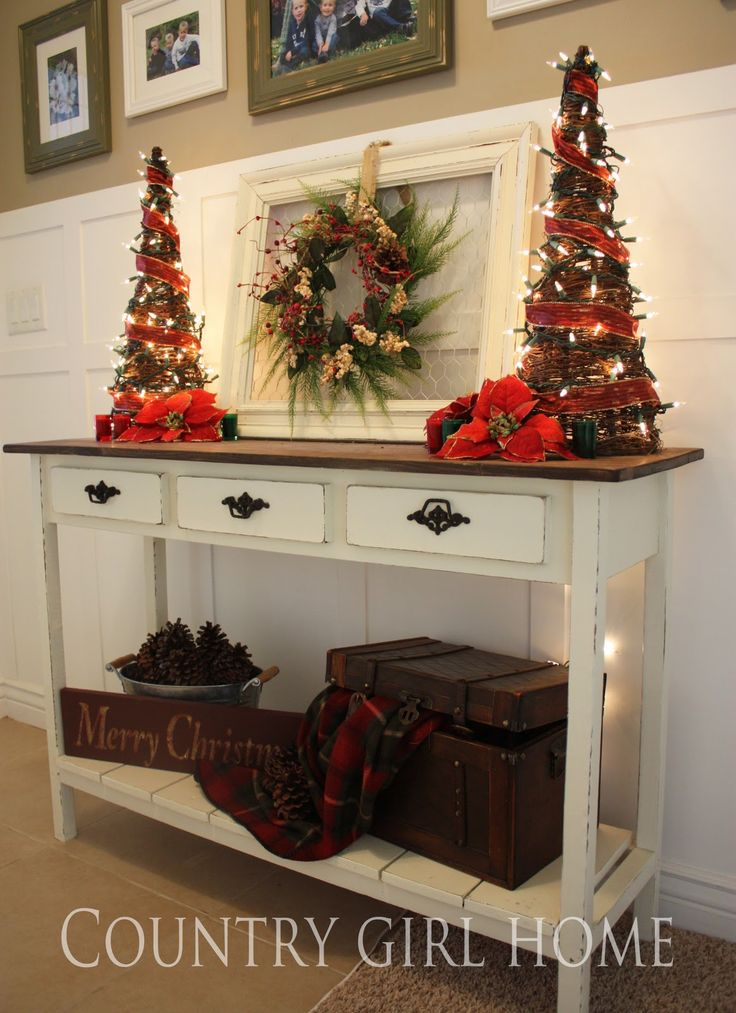 love the trees on both sides of the chicken wire frame with the wreath and the trunk with the blanket coming out