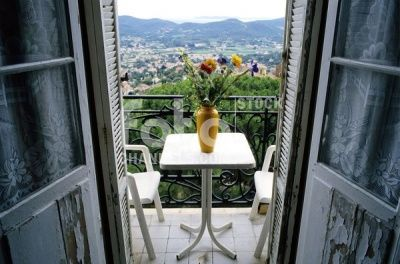 View, room to, balcony, table, vase, flowers, damaged doors, hotel, need, renovation, Bormes-les-Mimosas, Provence-Alpes-Cote d'Azur, Var, Southern France, France, Europe, Numer utworu: IBR0164336, Fotochannels