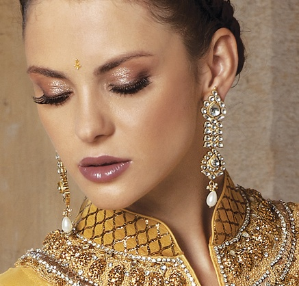 Long kundan earrings in antique gold finish with zircon and white crystal drop, priced at $139.