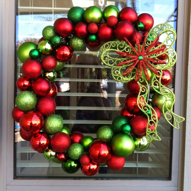 My dollar store Christmas ball wreath! Used the wire hangar method. Glued the extra ornaments with a hot glue gun.