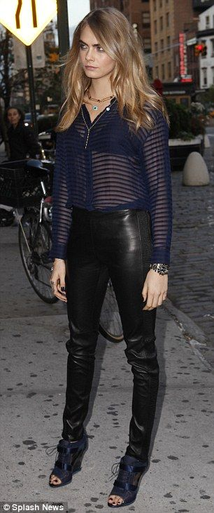 Cara Delevingne looks odd as she lunges in skin-tight leather trousers #dailymail